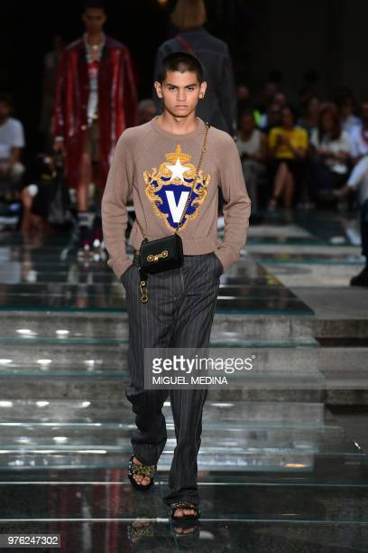 A model presents a creation by Versace during the men's spring/summer 2019 collection fashion show in Milan on June 16 2018