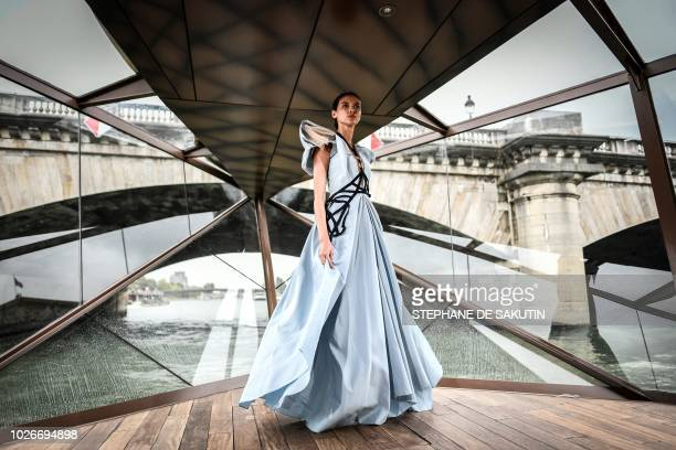 A model presents a creation by Vietnamese fashion show organiser and model Jessica Minh Anh during her 2018 fallwinter fashion show staged on a...
