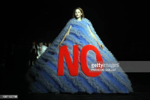 TOPSHOT A model presents a creation by Viktor and Rolf during the 2019 SpringSummer Haute Couture collection fashion show in Paris on January 23 2019