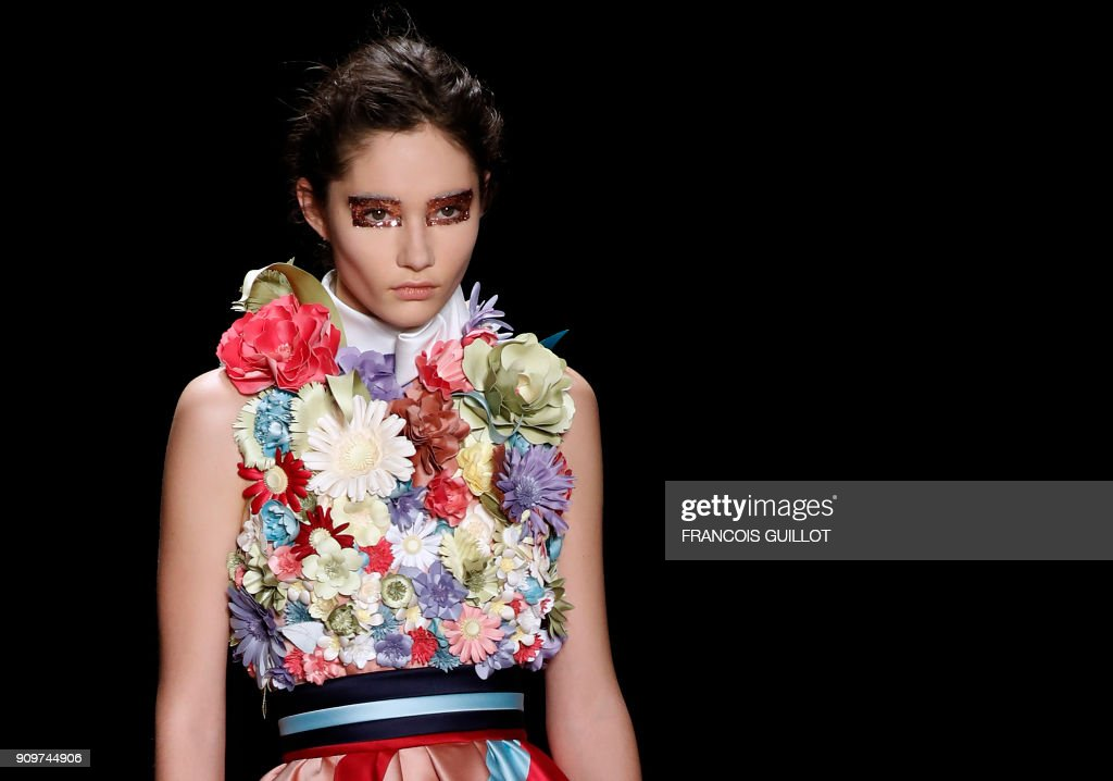 A model presents a creation by Viktor & Rolph during the 2018 spring/summer Haute Couture collection fashion show on January 24, 2018 in Paris. /