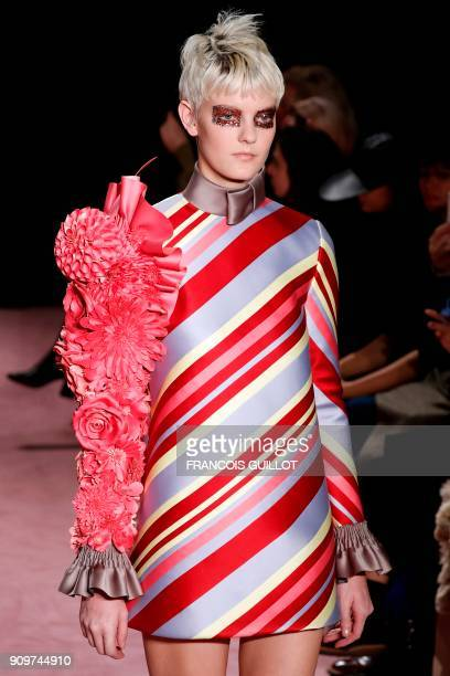 Model presents a creation by Viktor & Rolph during the 2018 spring/summer Haute Couture collection fashion show on January 24, 2018 in Paris. / AFP...