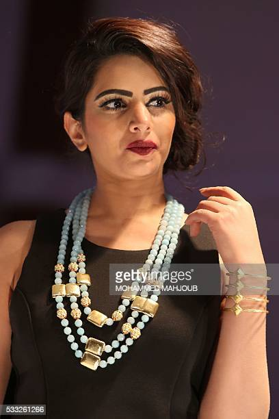 A model presents a creation by Vivat jewellery during the Omani Women's Fashion Trends event on May 21 in the capital Muscat / AFP / MOHAMMED MAHJOUB