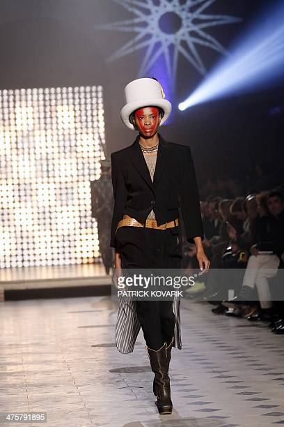 A model presents a creation by Vivienne Westwood during the 2014/2015 Autumn/Winter readytowear collection fashion show on March 1 2014 in Paris AFP...