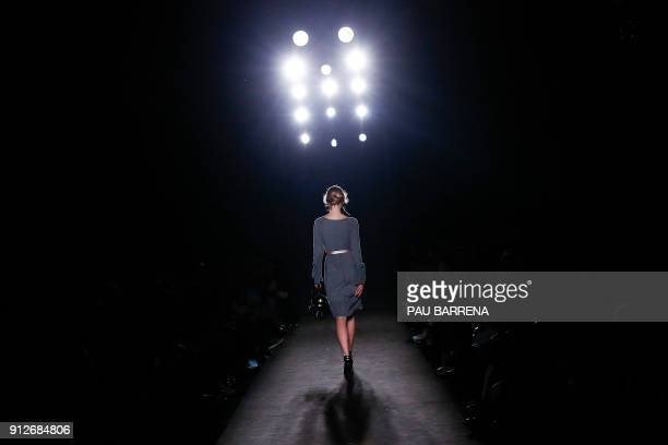A model presents a creation by Wom Now during the 080 Barcelona Fashion Week in Barcelona on January 31 2018 / AFP PHOTO / PAU BARRENA