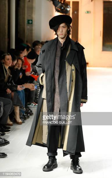 Model presents a creation by Yohji Yamamoto during the men's Fashion Week for the Fall/Winter 2020/21 collection in Paris on January 16, 2020.