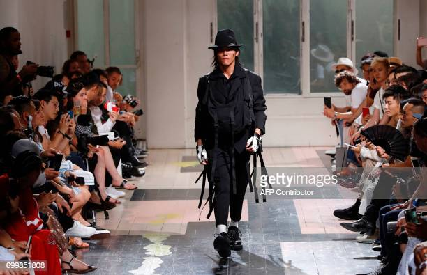 Model presents a creation by Yohji Yamamoto, during the Men's Fashion Week for the Spring/Summer 2018 collection on June 22, 2017 in Paris. / AFP...