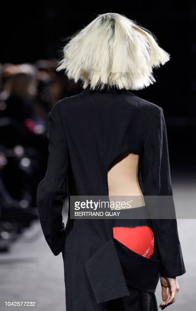 Model presents a creation by Yohji Yamamoto during the Spring-Summer 2019 Ready-to-Wear collection fashion show in Paris, on September 28, 2018.