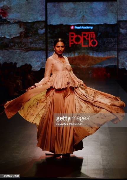 A model presents a creation by young fashion designers from Pearl Academy during the last day of the Amazon Fashion week 2018 on March 18 2018 / AFP...