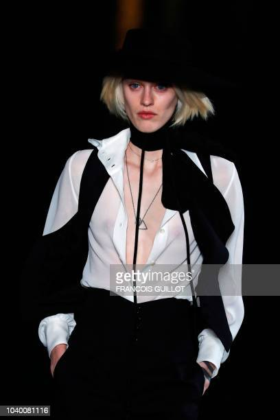 A modeldress detail walks the runway during the Saint Laurent show as part of the Paris Fashion Week Womenswear Spring/Summer 2019 on September 25...