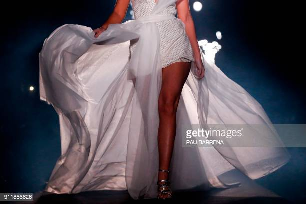 A model presents a creation by Ze Garcia during the 080 Barcelona Fashion Week in Barcelona on January 29 2018 / AFP PHOTO / PAU BARRENA