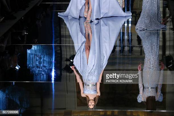 A model presents a creation by Zuhair Murad during the 2016 spring/summer Haute Couture collection on January 27 2016 in Paris / AFP / PATRICK KOVARIK