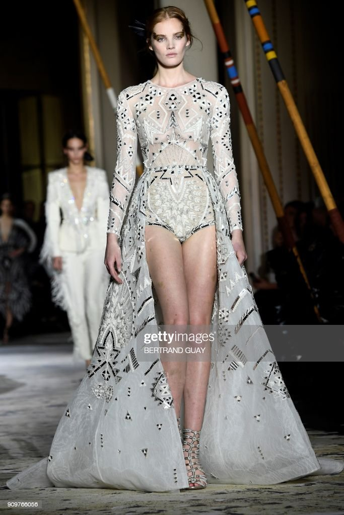 model-presents-a-creation-by-zuhair-murad-during-the-2018-haute-picture-id909766056