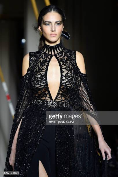 Model presents a creation by Zuhair Murad during the 2018 spring/summer Haute Couture collection fashion show on January 24, 2018 in Paris. / AFP...