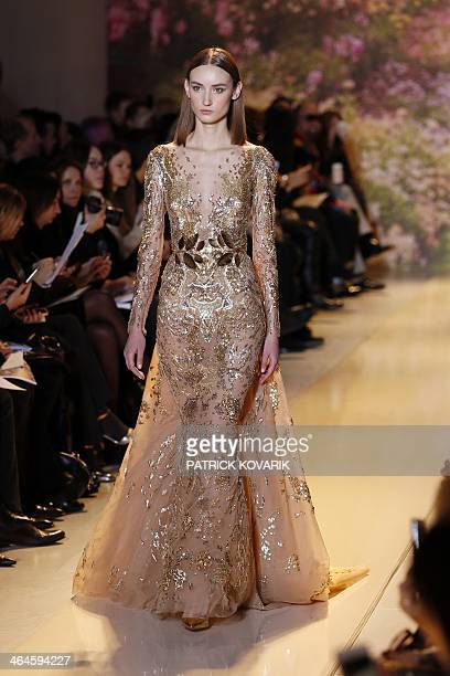 A model presents a creation by Zuhair Murad during the Haute Couture SpringSummer 2014 collection show on January 23 2014 in Paris AFP PHOTO /...