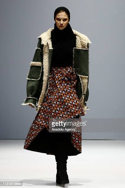 Model presents a creation during a catwalk show for the Autumn/Winter 2019/20 collection by Valentin Yudashkin at the Moscow Fashion Week in Moscow,...