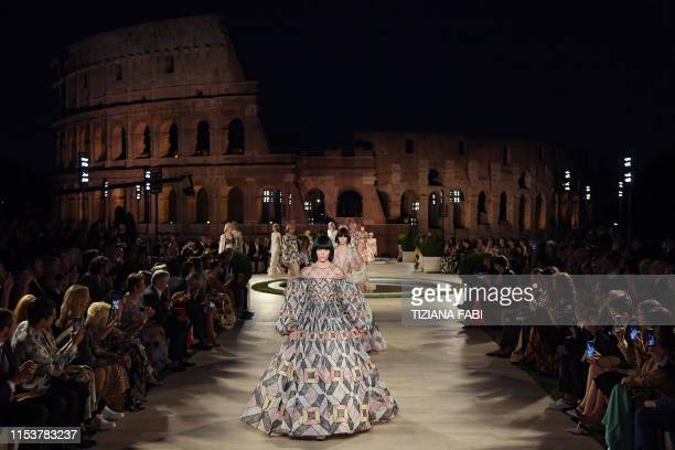 A model presents a creation during Italian fashion house Fendi's Couture Fall/Winter 20192020 show on July 4 2019 at the Palatine Hill in Rome with...
