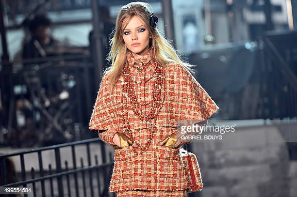 A model presents a creation during the 12th Chanel Metiers dArt show ParisRome an annual event to honor craftsmanship that artisan partners bring to...