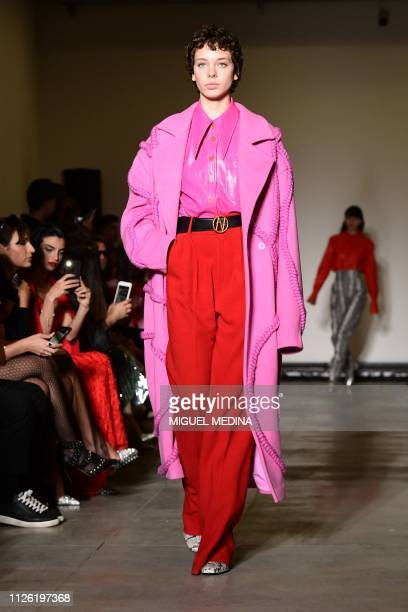 A model presents a creation during the Annakiki women's Fall/Winter 2019/2020 collection fashion show on February 20 2019 in Milan