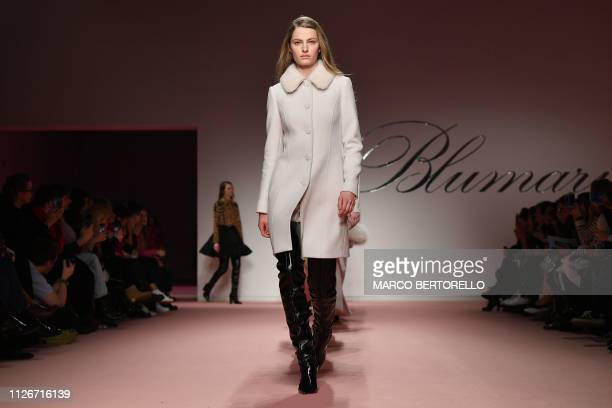 A model presents a creation during the Blumarine women's Fall/Winter 2019/2020 collection fashion show on February 22 2019 in Milan