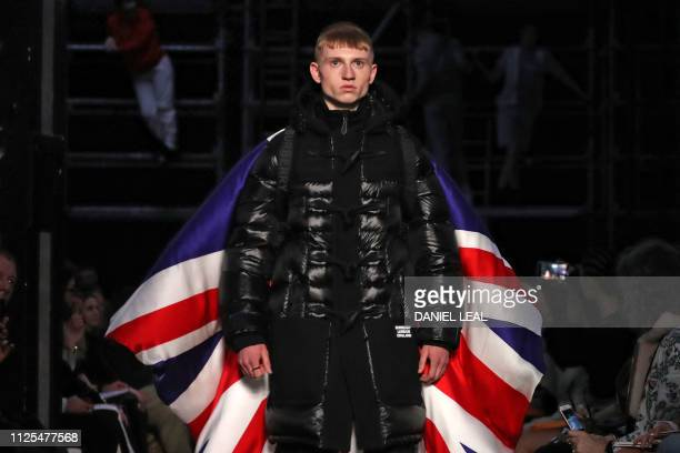A model presents a creation during the British fashion house Burberry 2019 Autumn / Winter collection catwalk show at London Fashion Week in London...