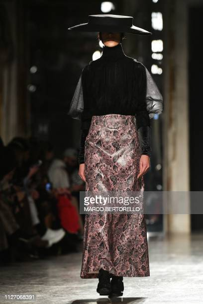 A model presents a creation during the Chika Kisada women's Fall/Winter 2019/2020 collection fashion show on February 24 2019 in Milan