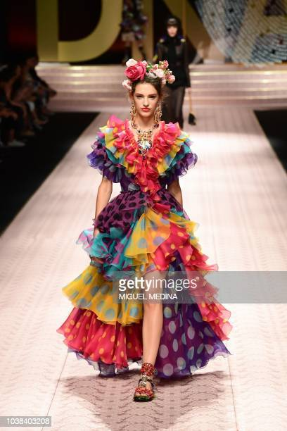 A model presents a creation during the Dolce Gabbana fashion show as part of the Women's Spring/Summer 2019 fashion week in Milan on September 23 2018