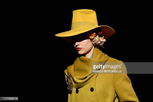 TOPSHOT A model presents a creation during the Dolce Gabbana women's Fall/Winter 2019/2020 collection fashion show on February 24 2019 in Milan