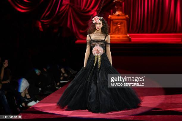 Model presents a creation during the Dolce & Gabbana women's Fall/Winter 2019/2020 collection fashion show, on February 24, 2019 in Milan.