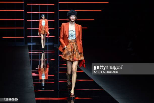 Model presents a creation during the Emporio Armani women's Fall/Winter 2019/2020 collection fashion show, on February 21, 2019 in Milan.