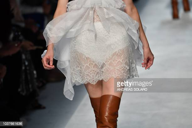 A model presents a creation during the Ermanno Scervino Women's Spring/Summer 2019 fashion show in Milan on September 22 2018