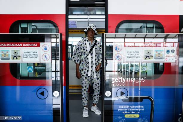 A model presents a creation during the fashion show in a light rail transit system in Jakarta Indonesia on August 13 2019