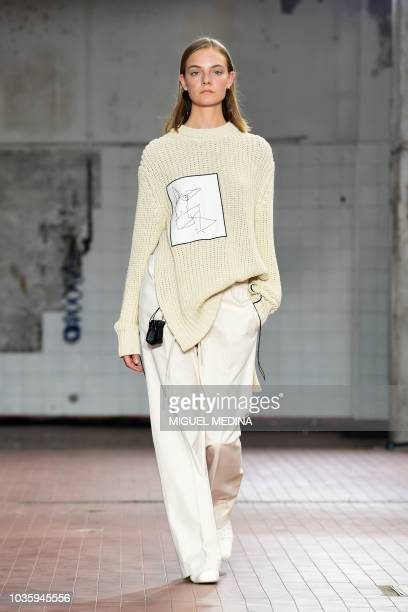 A model presents a creation during the Jil Sander Women's Spring/Summer 2019 fashion show in Milan on September 19 2018