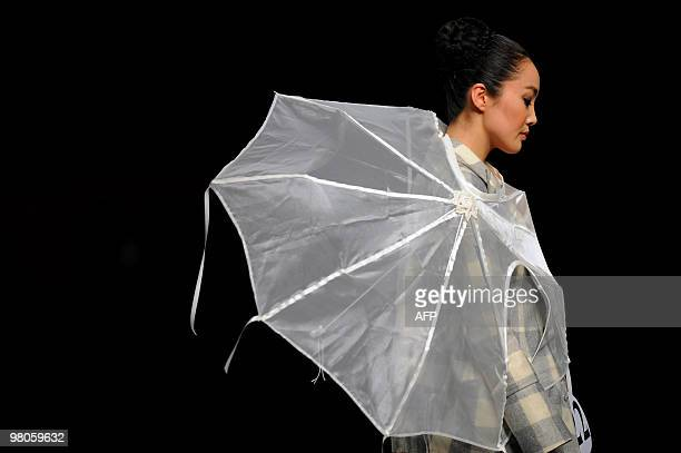 Model presents a creation during the opening ceremony of China Fashion Week Autumn/Winter 2010-2011 and the Hempei Award for the 18th International...