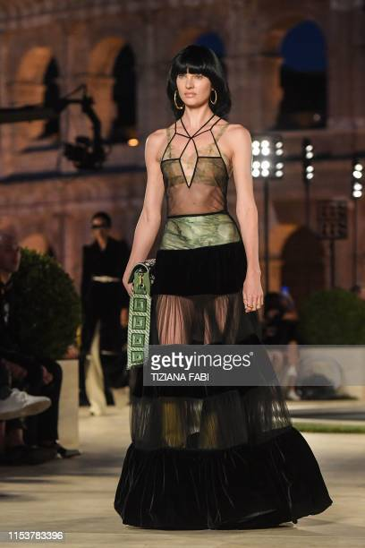 A model presents a creation during the outdoors presentation of Italian fashion house Fendi's Couture Fall/Winter 20192020 show on July 4 2019 at the...