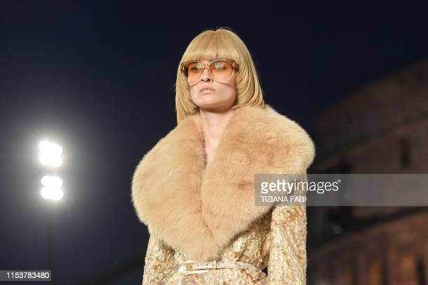 Model presents a creation during the outdoors presentation of Italian fashion house Fendi's Couture Fall/Winter 2019-2020 show on July 4, 2019 at the...