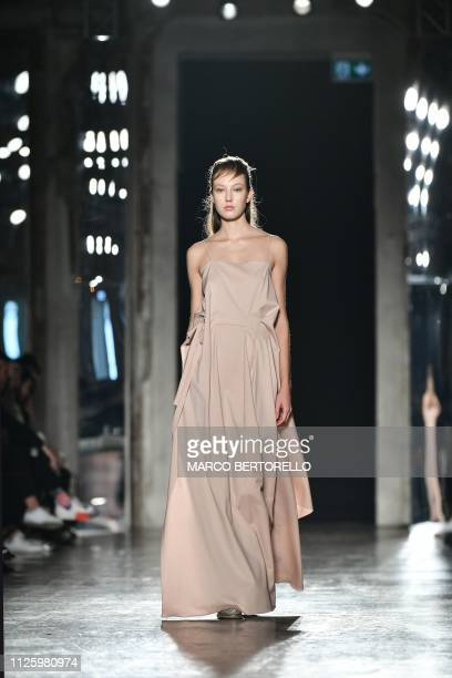 A model presents a creation during the Zambelli women's Fall/Winter 2019/2020 collection fashion show on February 20 2019 in Milan