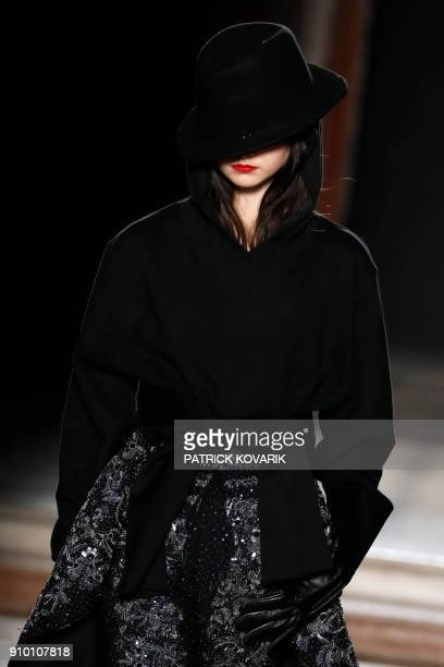 A model presents a creation for AF Vandevorst during the 2018 spring/summer Haute Couture collection fashion show on January 25 2018 in Paris / AFP...