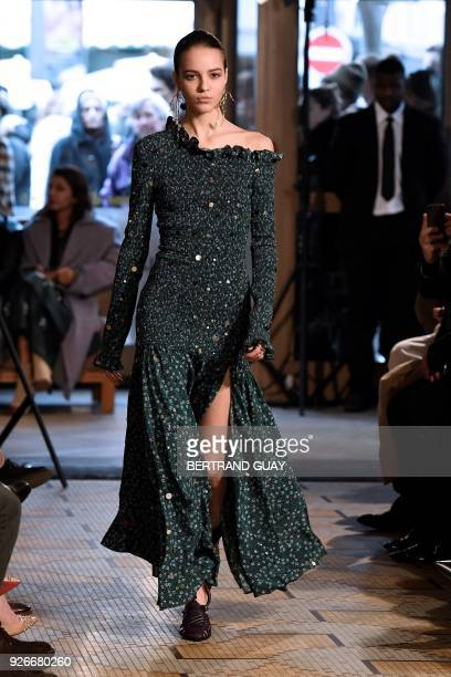 TOPSHOT A model presents a creation for Altuzarra during the 2018/2019 fall/winter collection fashion show on March 3 2018 in Paris / AFP PHOTO /...