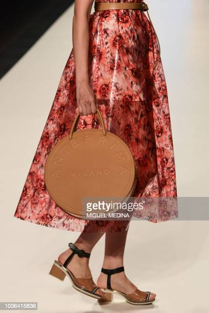 A model presents a creation for Anteprima fashion house during the Women's Spring/Summer 2019 fashion shows in Milan on September 20 2018