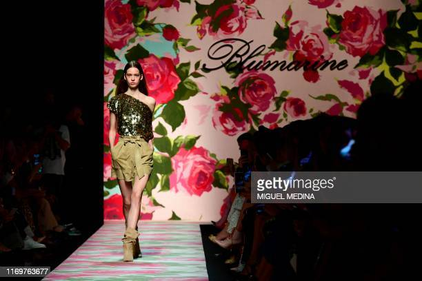 Model presents a creation for Blumarine during the Women's Spring Summer 2020 collection fashion show on September 20, 2019 in Milan.