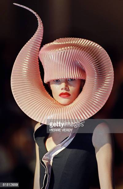 A model presents a creation for British designer Philip Treacy 10 July 2001 in Paris during the AutumnWinter 2001/2002 haute couture collections AFP...