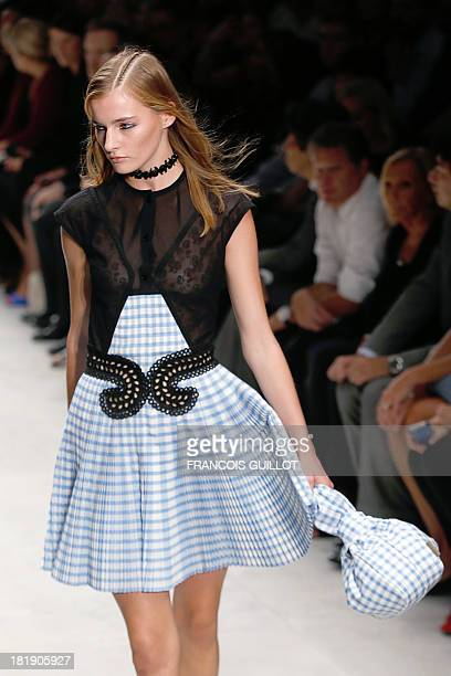 A model presents a creation for Carven during the 2014 Spring/Summer readytowear collection fashion show on September 26 2013 in Paris AFP PHOTO /...