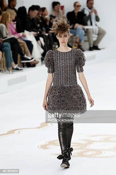 A model presents a creation for Chanel during the 2014/2015 Haute Couture FallWinter collection fashion show on July 8 2014 at the Grand Palais in...