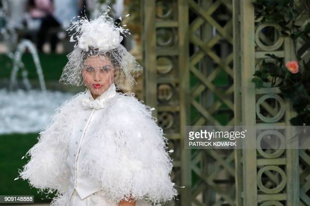 TOPSHOT A model presents a creation for Chanel during the 2018 spring/summer Haute Couture collection fashion show on January 23 2018 in Paris