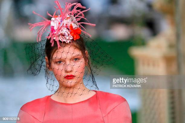 A model presents a creation for Chanel during the 2018 spring/summer Haute Couture collection fashion show on January 23 2018 in Paris / AFP PHOTO /...