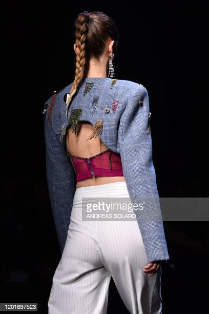 A model presents a creation for Chinese designer Han Wen's Fall Winter 2020 collection as part of the China We are With You fashion event kicking off...