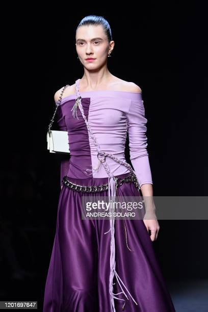 """Model presents a creation for Chinese designer Han Wen's Fall - Winter 2020 collection, as part of the """"China, We are With You"""" fashion event,..."""