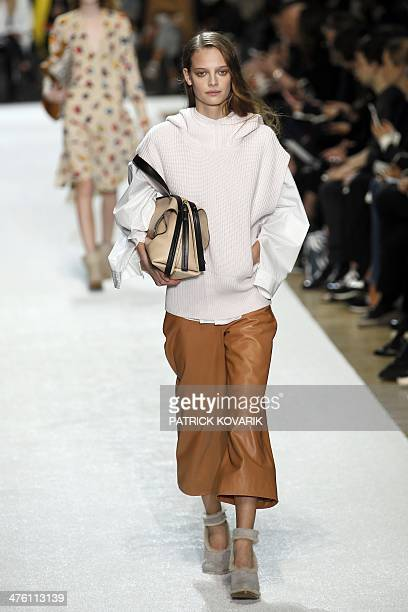A model presents a creation for Chloe during the 2014/2015 Autumn/Winter readytowear collection fashion show on March 2 2014 in Paris AFP PHOTO /...