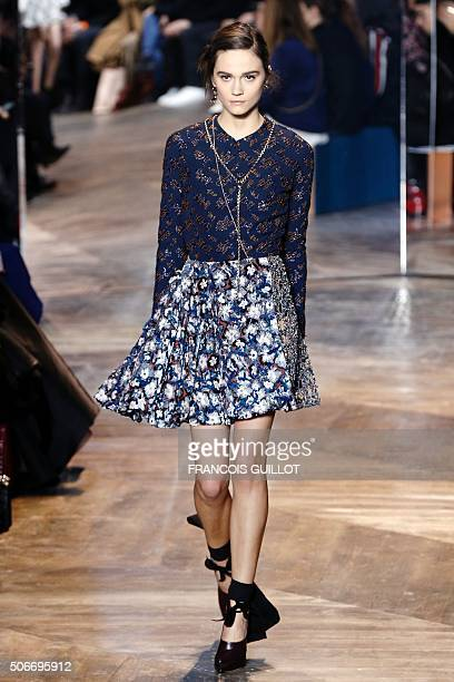 A model presents a creation for Christian Dior during the 2016 spring/summer Haute Couture collection fashion presentation on January 25 2016 in...