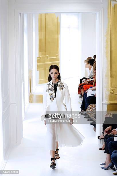 A model presents a creation for Christian Dior during the 20162017 fall/winter Haute Couture collection fashion show on July 4 2016 in Paris / AFP /...